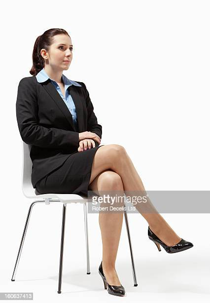Seated business woman looking relaxed