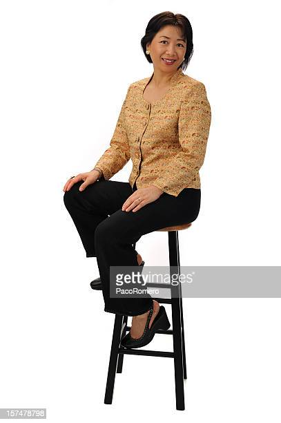seated chinese businesswoman - stool stock pictures, royalty-free photos & images