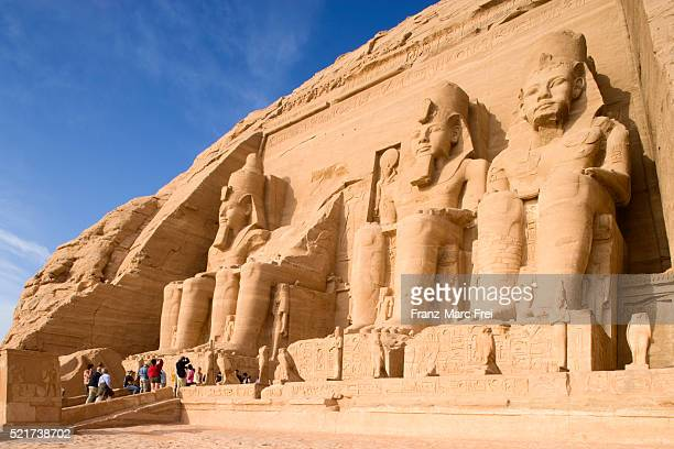 seated colossi of ramesses ii at abu simbel temple - pharaoh stock pictures, royalty-free photos & images