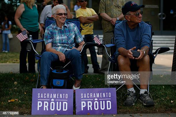 A seated couple watch the parade honoring Alek Skarlatos Anthony Sadler and Spencer Stone for their August 21 actions in overpowering a gunman on a...