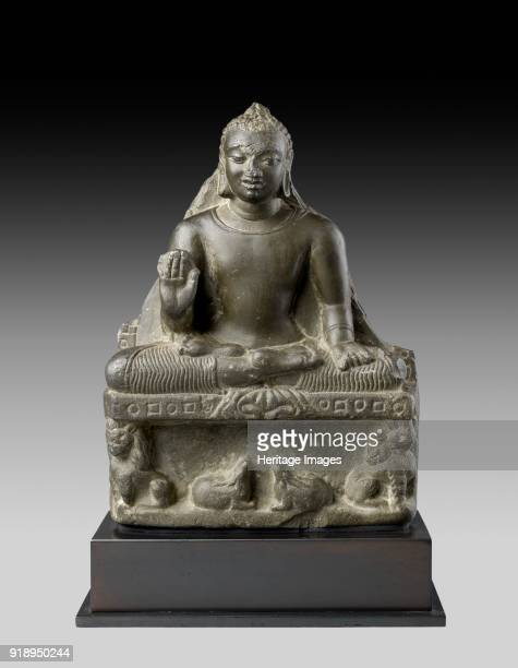 Seated figure of the Buddha 5th 6th century Dimensions height x width x depth with mount 23 x 159 x 56 cm maxheight x width x depth 19 x 14 x 45 cm...
