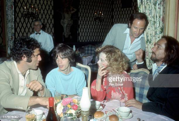 Seated from left American actor Elliott Gould British singer Mick Jagger South African actress and singer Genevieve Waite and her husband musician...