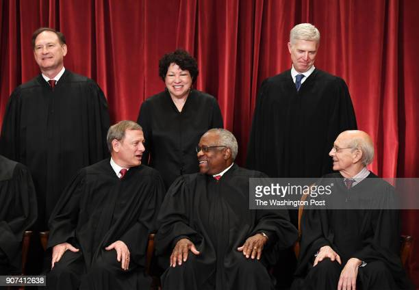 Seated from left, Chief Justice of the United States John G. Roberts, Associate Justice Clarence Thomas, and Associate Justice Stephen Breyer....
