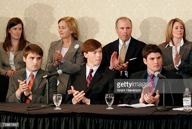 Seated from left Duke lacrosse players David Evans Colin Finnerty and Reade Seligman listen during a news conference at the Sheraton Raleigh Hotel...