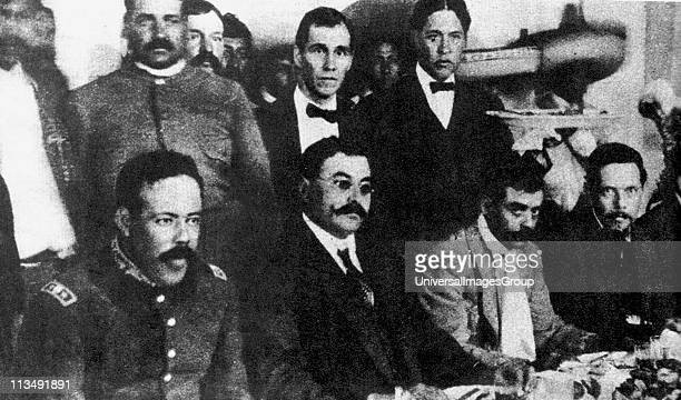 Seated from left to right Doroteo Arango Arambula known as Pancho Villa Mexican revolutionary general Eulalio Gutierrez Mexican politician President...