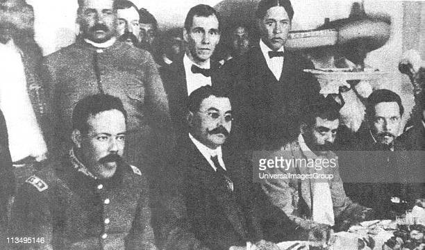 Seated from left to right Pancho Villa Eulalio Gutierrez Emiliano Zapata and Felicitas Villareal