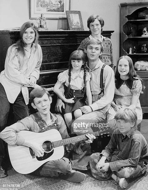 Seated in a living room set from CBS's The Waltons television show are the children of the show photographed in 1975 counterclockwise from bottom...