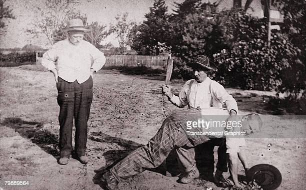 A seated man wields a paddle to spank a man leaning over his lap as a third man stands by to watch ca1910 The image was originally labeled 'Witness...