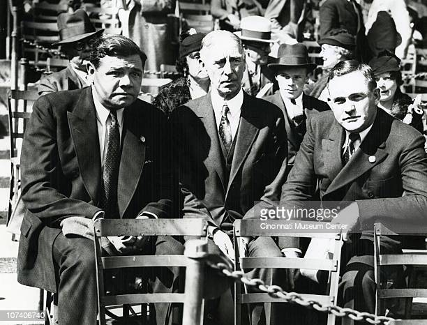 Seated next to each other at a stadium are, left to right, noted baseball player George Herman 'Babe' Ruth , ballplayer, manager, and team owner...