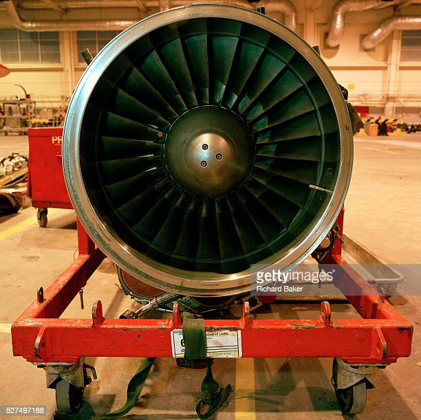 Seated on a cradle in an RAF hangar is a RollsRoyce/Turbomeca Adour Mk 151 jet engine belonging to the 'Red Arrows' Britain's Royal Air Force...