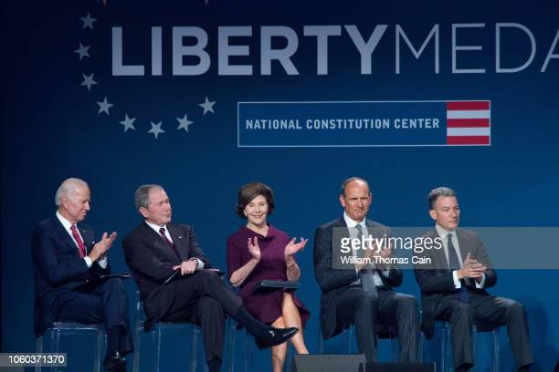Seated on the dais are former Vice President Joe Biden, former US President George W. Bush, Laura Bush, National Constitution Center Executive...
