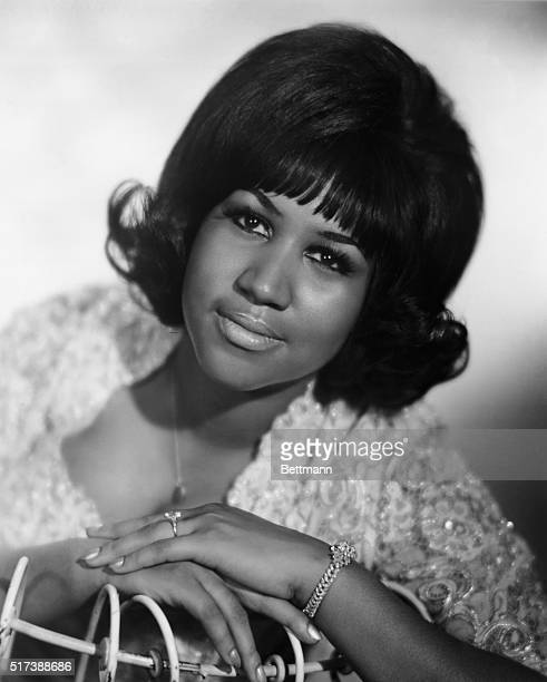 Seated portrait of RB singer Aretha Franklin during her youth In this photo her left hand is featured prominently with a diamond bracelet on her...