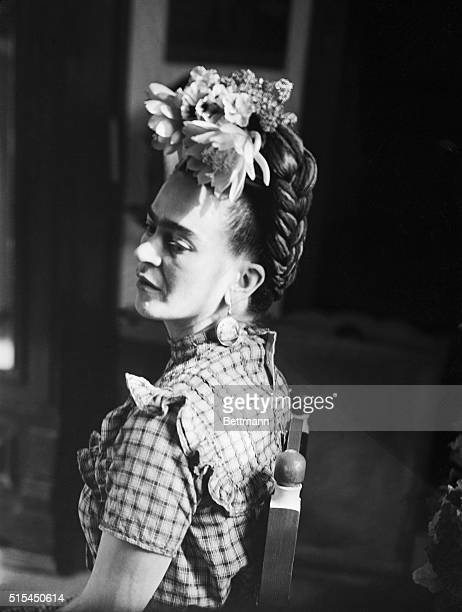 Seated profile photograph of Frida Kahlo Mexican painter and wife of Diego Rivera