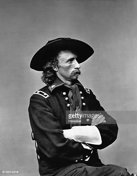 A seated rightprofile of George Armstrong Custer in major general's uniform some time after October 19 1864 The uniform features long gloves...