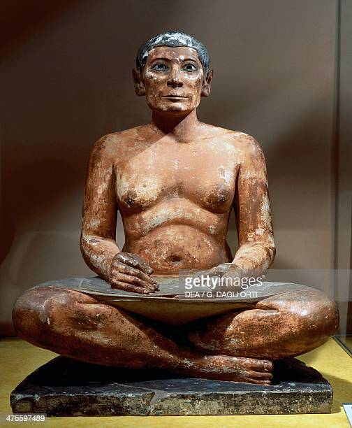 Seated scribe or Squatting scribe limestone statue with rock crystal magnesite and alloy of copper and arsenic used for the eyes nipples in wood cm...