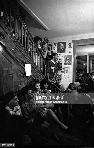 Seated second from left poet Gwendolyn Brooks sits while listening to friends family and fellow literary figures celebrate her 50th birthday Chicago...
