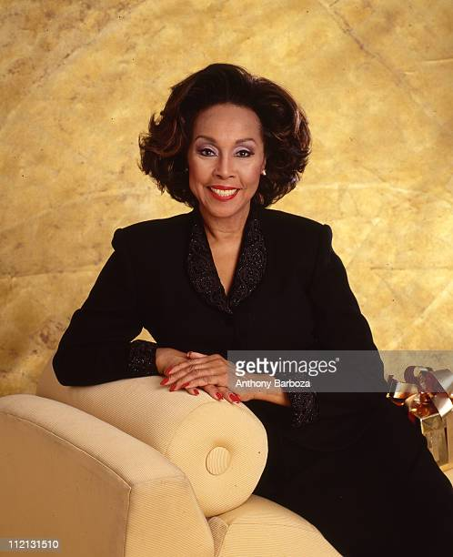 Seated smiling portrait of American actress Diahann Carroll New York 2000