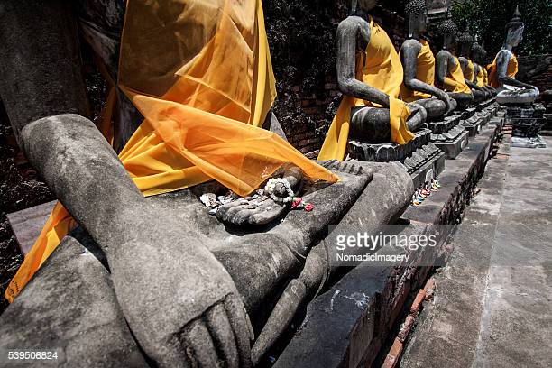 Seated stone carved Buddhas robed in gold