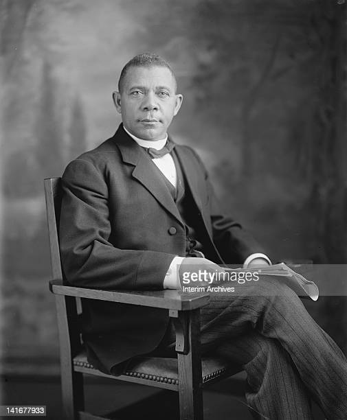 Seated studio portrait of American educator economist and industrialist Booker T Washington founder of the Tuskegee Institute in Alabama early...