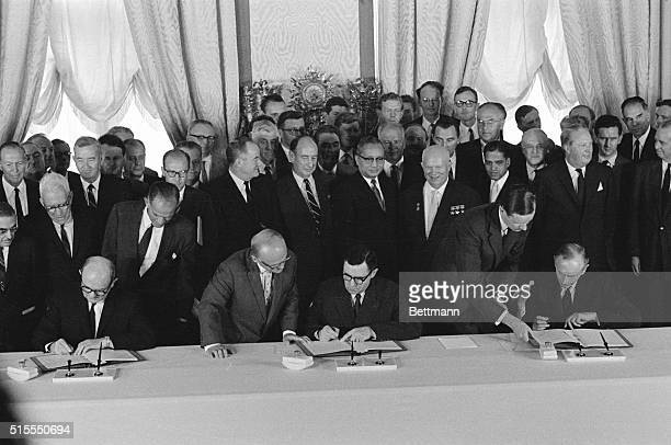 Seated to sign threenation nuclear test ban in the Kremlin's St Catherine's Hall on August 5th are US Secretary of State Dean Rusk Soviet Foreign...