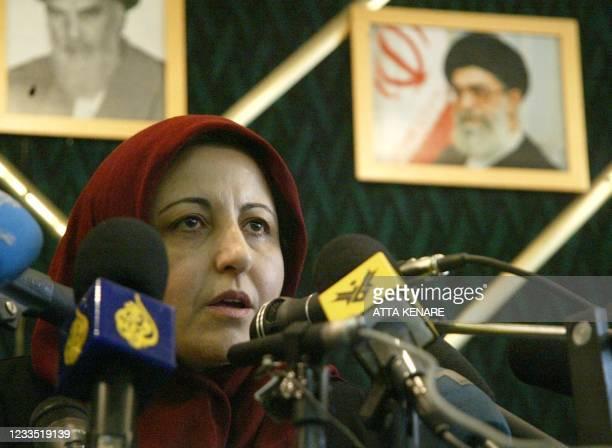 Seated under portraits of the late founder of the Islamic republic Ayatollah Ruhollah Khomeini and his successor, Iran's supreme leader Ayatollah Ali...