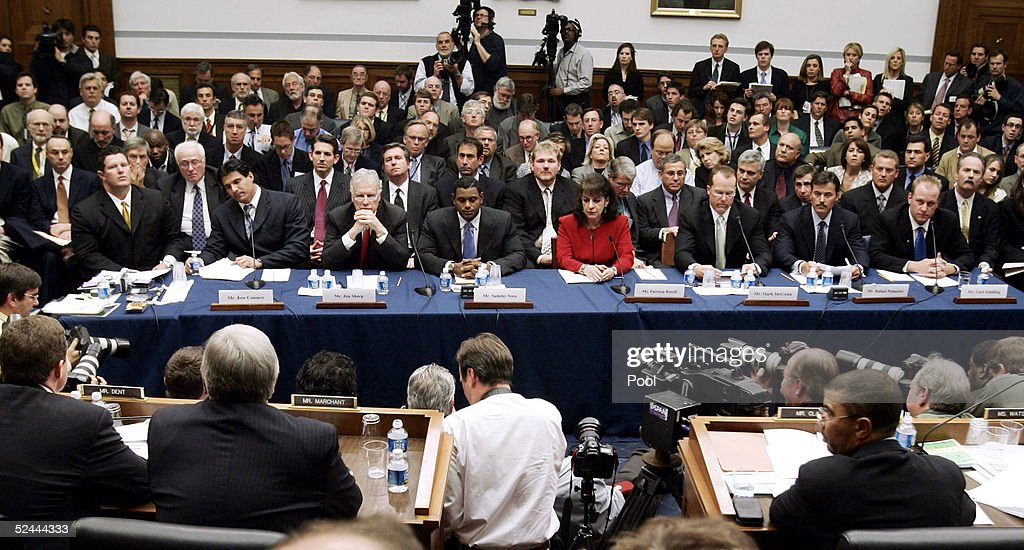 Seated witnesses wait to testify on March 17, 2005 during a House committee that is investigating the efforts by Major League Baseball to eradicate steroid use among its players in Washington, DC. Seated from left are Jose Canseco's lawyer Robert Saunooke, Jose Canseco, Sammy Sosa's lawyer Jim Sharp, Sammy Sosa, his interpreter Patricia Rosell, Mark McGwire, Rafael Palmiero, and Curt Schilling.