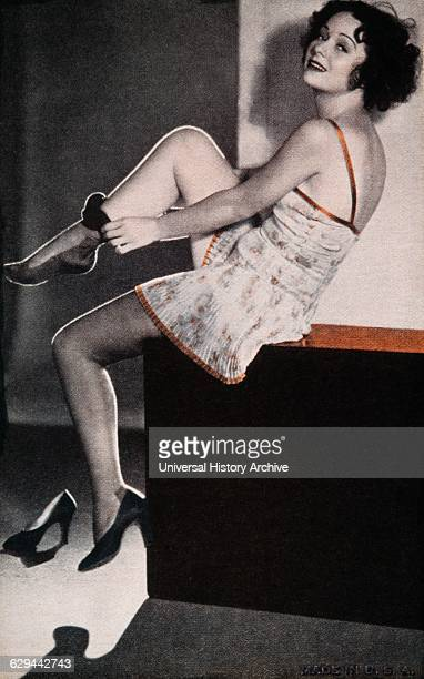 Seated Woman Putting on Nylon Stockings Pinup Card 1940's