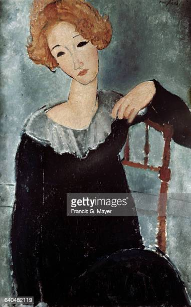 Seated Young Blond Woman by Amedeo Modigliani
