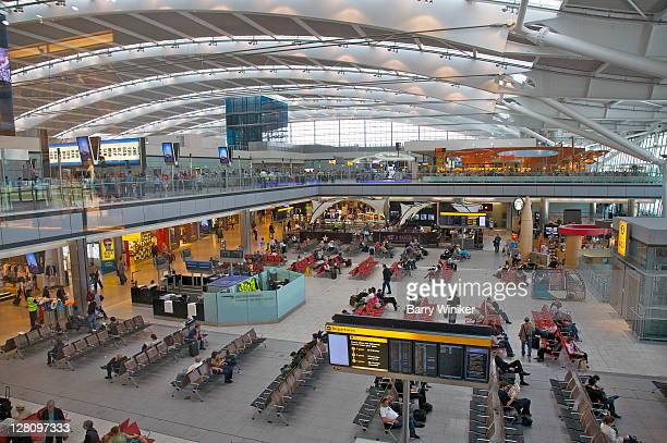 Seating area, glass balcony and ceiling design at gate in Aerogare, Terminal 2, Charles De Gaulle Airport, Paris