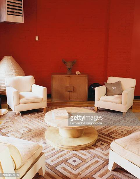 Seating Area in Living Room with Painted Brick Walls