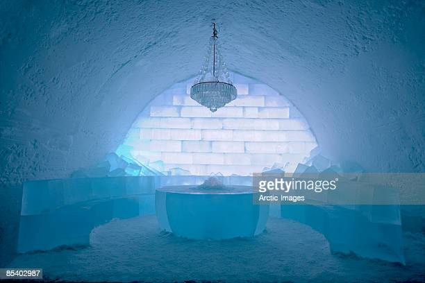 seating area, with chandelier, ice hotel - ice hotel sweden stock pictures, royalty-free photos & images