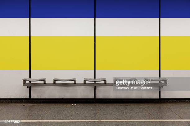 seating bench with blue and yellow stripe - christian beirle gonzález stock pictures, royalty-free photos & images