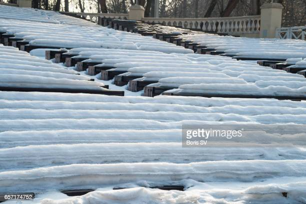 Seating rows of concert pavilion covered with snow