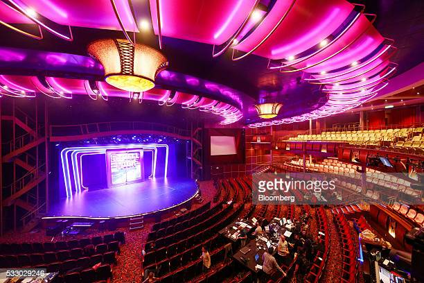 Seating surrounds the stage area in a theater on board the Royal Caribbean Cruise Ltd's Harmony of the Seas Oasisclass cruise ship docked in...