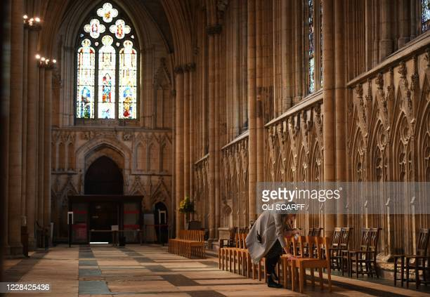 Seats are cleaned before members of the York Minster Choir perform specially commissioned anthems to mark the resumption of choral signing at York...