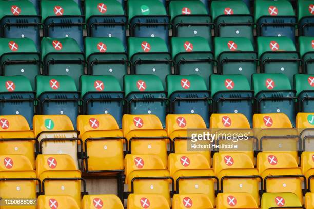 Seats are marked inside the stadium aknowledging social distancing measures ahead of the Premier League match between Norwich City and Southampton FC...