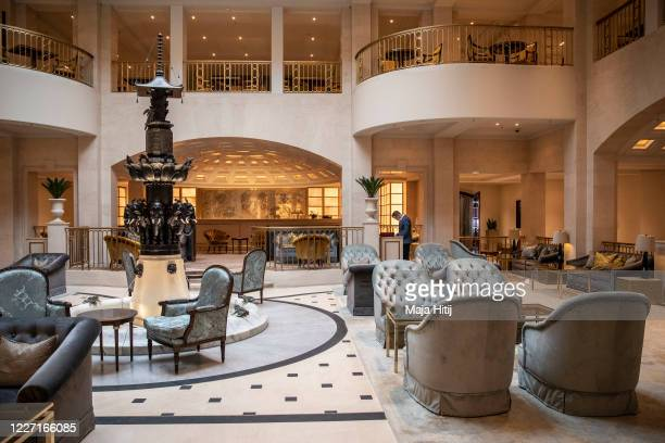 Seats are placed apart to provide social distance at a lobby at the Hotel Adlon Kempinski on May 26, 2020 in Berlin, Germany. As European countries...