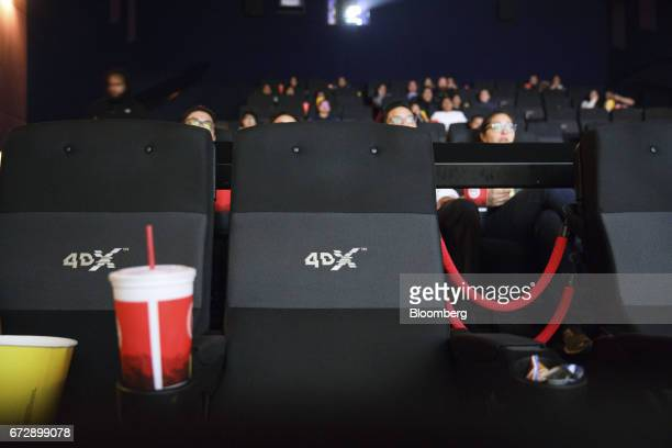 Seats featuring special movement and environmental effects stand inside a 4DX theater before a showing of 'The Fate of The Furious' at the Regal...