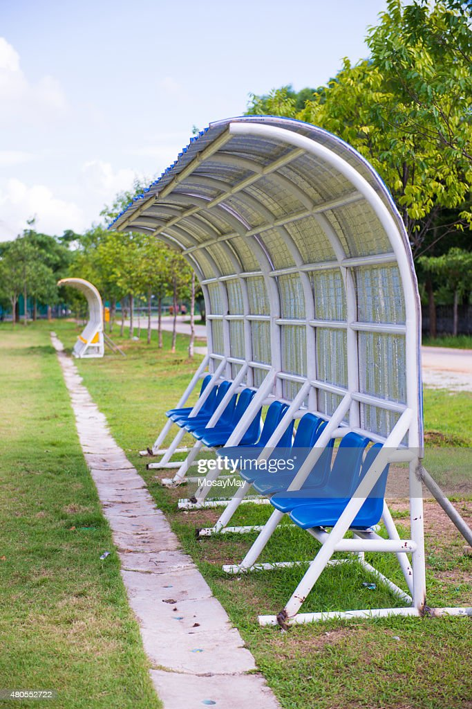 seats for coaches and athletes on the football field : Stock Photo