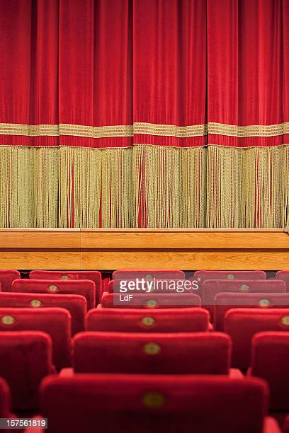 seats in a theatre with velvet curtain on the background - classical theater stock pictures, royalty-free photos & images