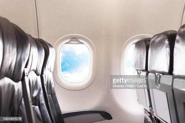 seats in airplane - vehicle interior stock pictures, royalty-free photos & images
