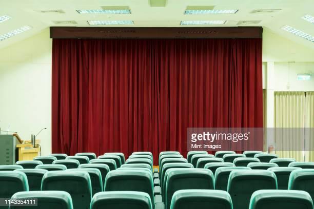 seats in empty auditorium - 講堂 ストックフォトと画像