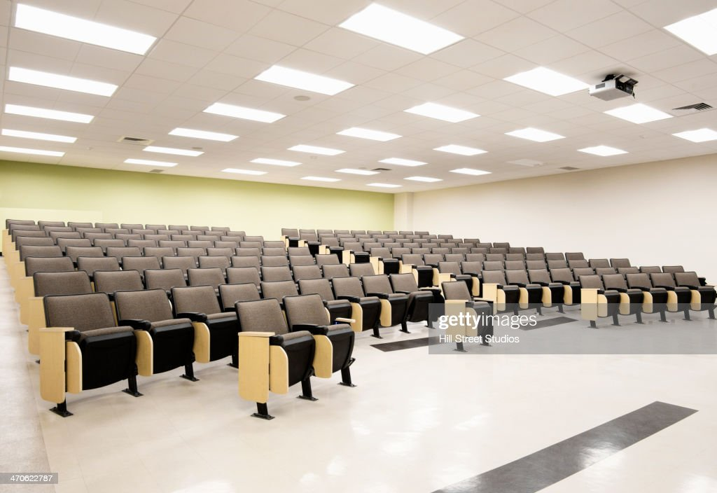 Seats in empty lecture hall : Stock Photo