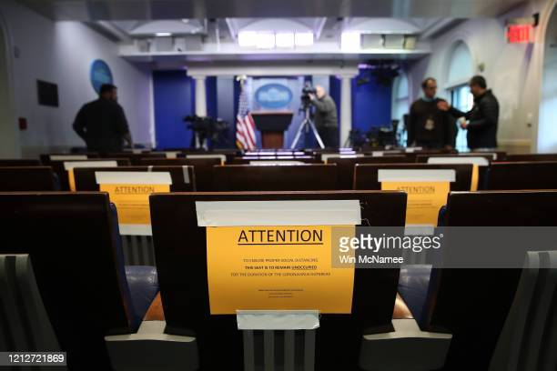 Seats in the White House press briefing room are marked with warnings to maintain social distancing March 16 2020 in Washington DC In addition to...