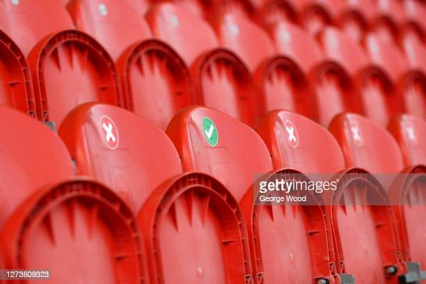 Seats inside the stadium are marked out for social distancing ahead of the Sky Bet League Two match between Harrogate Town and Walsall at The...