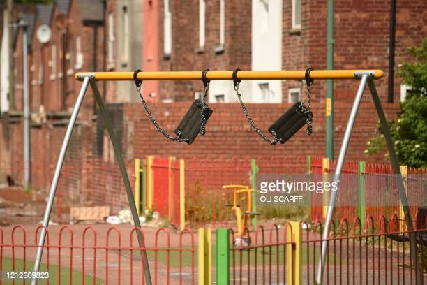 Seats of a swing are seen tied up to prevent use in a playground in Manchester northwest England on May 11 as life in Britain continues during the...