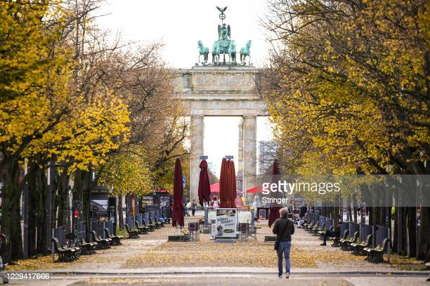 Seats of closed coffee shops are seen at Unter den Linden street on the first day of a four-week semi-lockdown during the second wave of the...