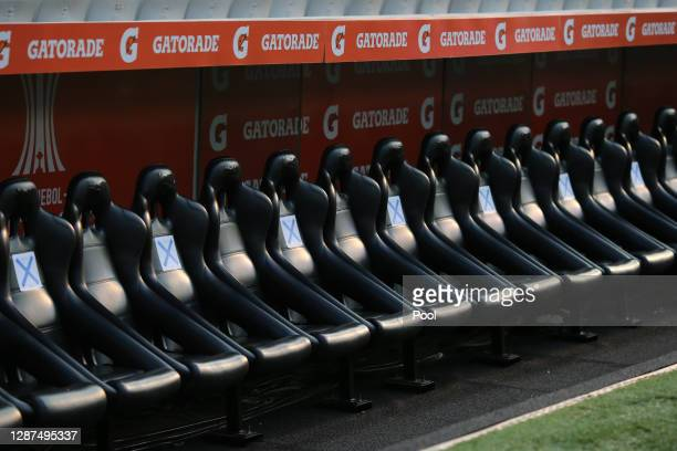 Seats of the bench are marked with a cross to keep distance as a measure to prevent spread of COVID-19 before a round of sixteen first leg match...