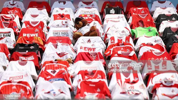 TOPSHOT Seats on the tribune are covered with team shirts prior to the German first division Bundesliga football match FC Cologne v Mainz 05 on May...
