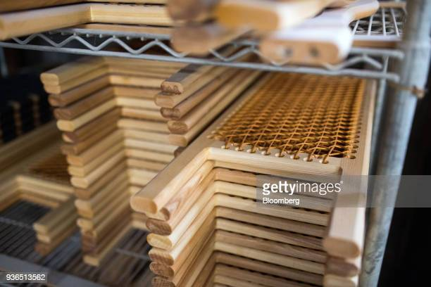 Seats sit stacked on a shelf before being installed into canoes at the Holy Cow Canoe Co production facility in Guelph Ontario Canada on Thursday...